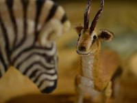 Erzaehlen mit den Figuren eines Zebras und einer Gazelle
